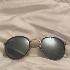 Silver circle Ray Bans with a Navy and Gold liner